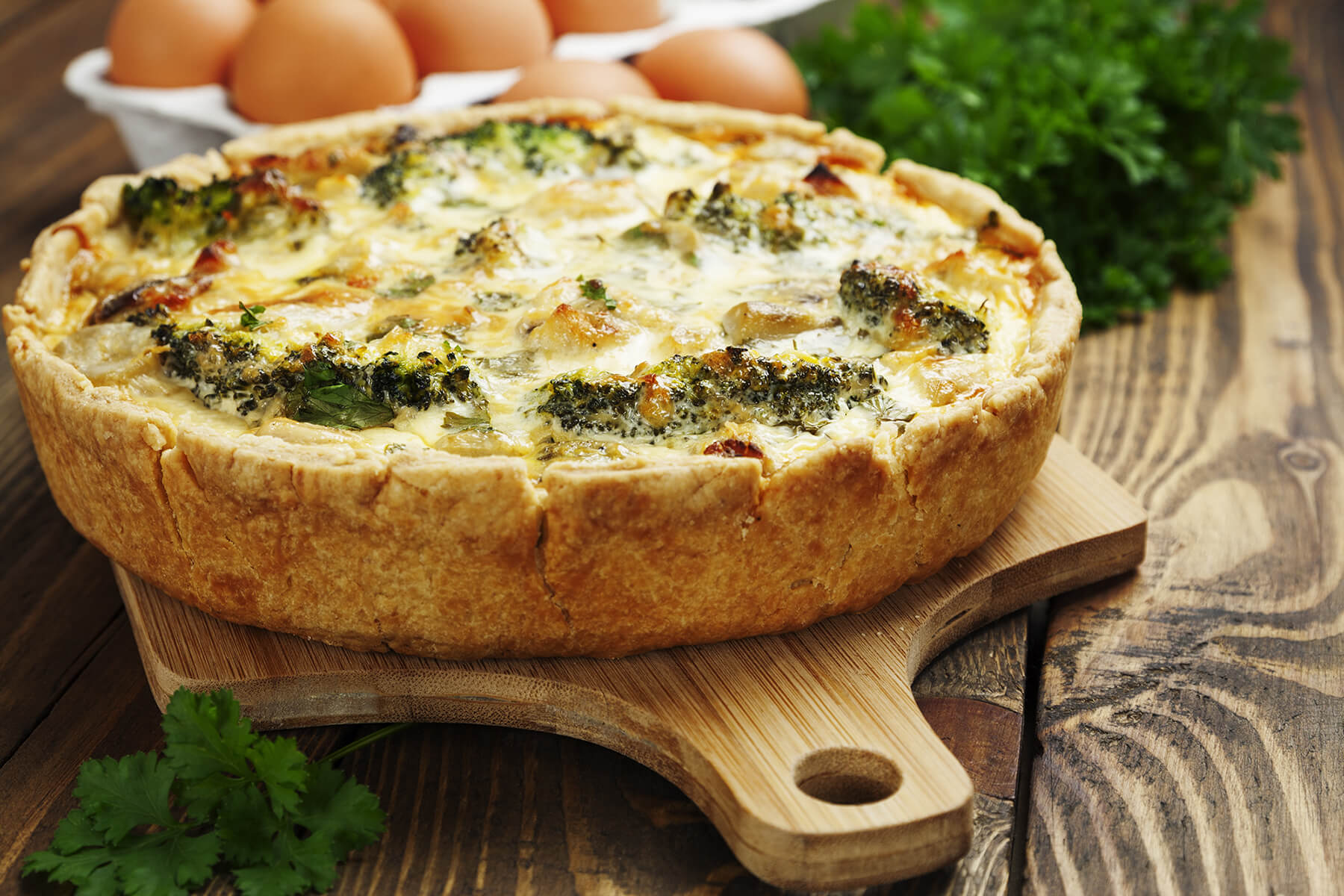 quiche Lorraine with chicken, mushrooms and broccoli on the table