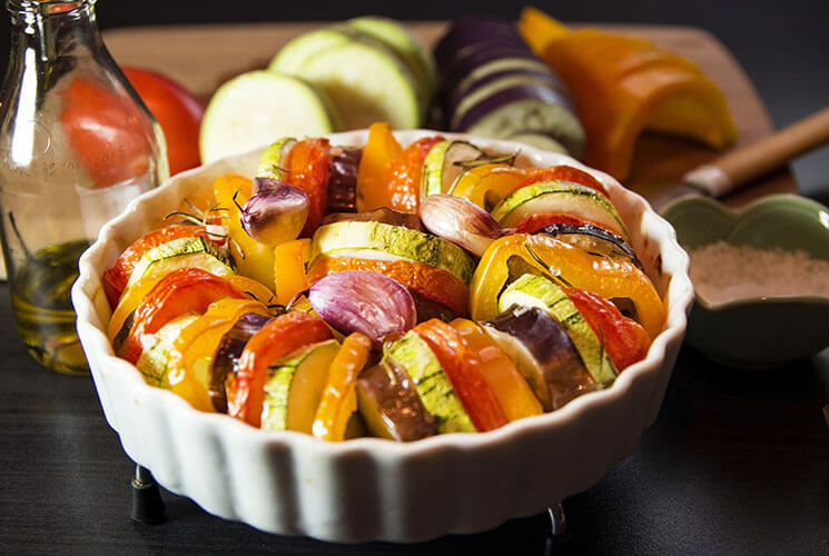 Roasted vegetables. Rustic ratatouille with tomatoes, zucchini, egg plant and bell pepper.